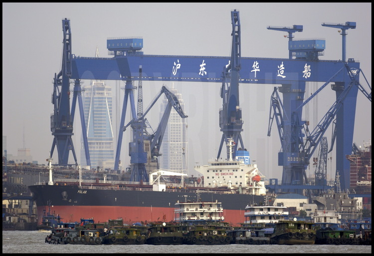Gas tanker Polar (capacity : 71000 m3), belonging to Great Britain, outside of Qing Yin Si shipyard main crane, situated on the right rim of the Huang Pu river. On background, northern towers of Pudong (meaning
