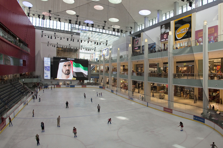 Inside the Dubai Mall (largest mall in the world), the only ice rink in the emirate. In the background, the portrait of Sheikh Ahmed Al Maktoum, omnipotent ruler of Dubai.