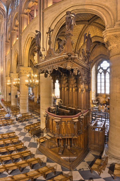 South of the nave, up to the fourth arch, the pulpit of Notre Dame, carved in wood.