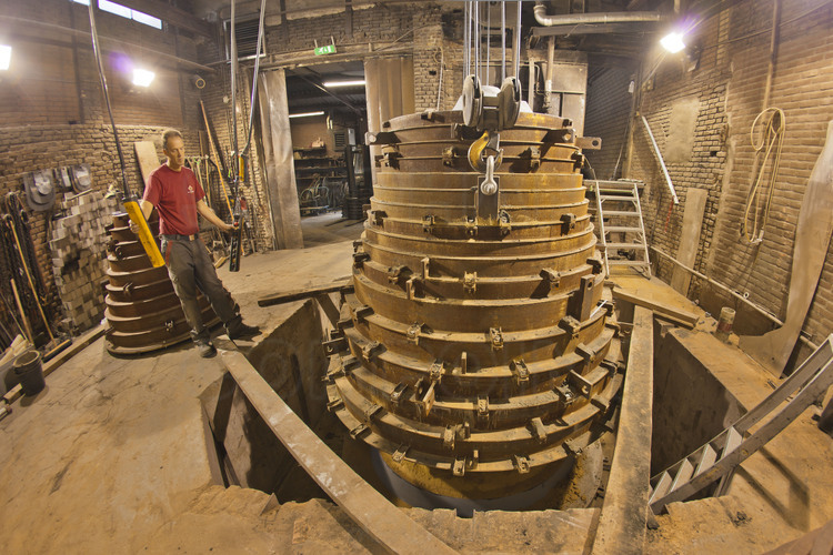 Asten, Netherlands. Royal Eijsbouts foundry, August 31, 2012. Wim Hurkmans, responsible for the foundry workshop, extract the mold of Mary (G sharp), a big bell of 6.2 tons intended to accompany the great bell Emmanuel in the southern Tower.