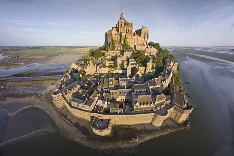 Overview of the Mont Saint Michel as seen from the east. In the foreground, the ramparts and the village.