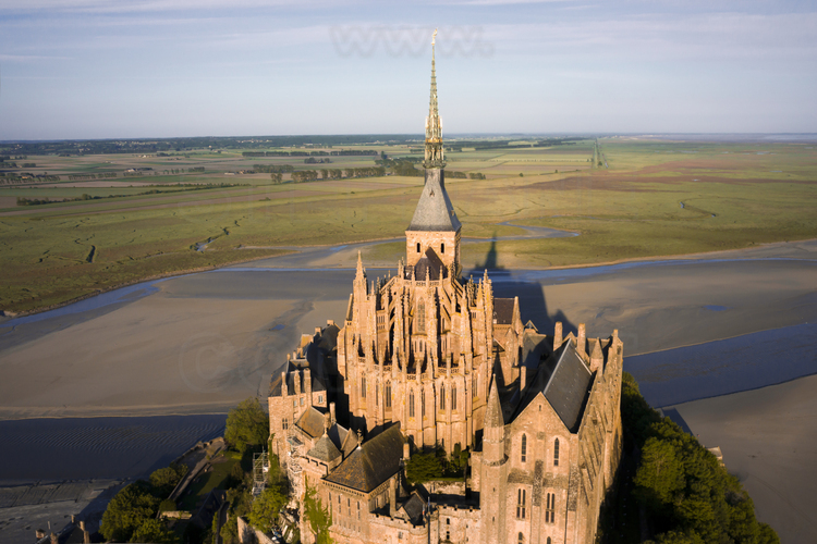 Overview of the Mont Saint Michel from the east. In the foreground, the chevet of the church. On the right, the Wonder.