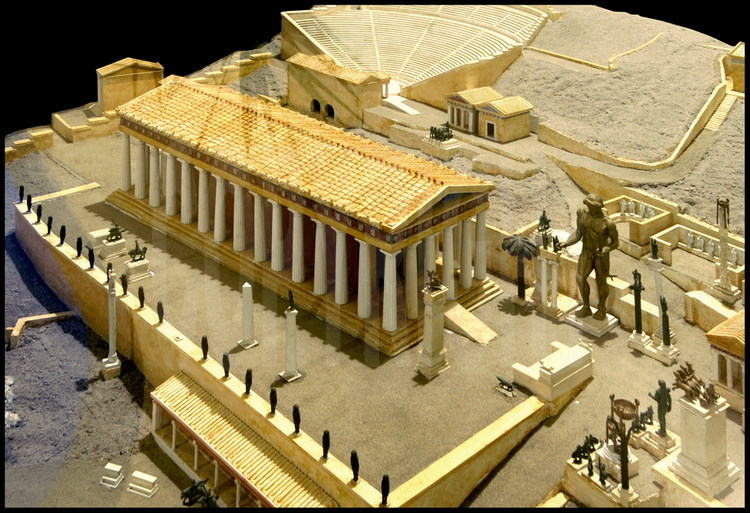 Representation of the center of Apollo's sanctuary in Delphi.  In the center, the temple of Apollo erected during the 4th century B.C.  On the right, the colossal statue of the god Apollo by sculptor Sitalcas.  In the background, the amphitheater also built in the 4th century B.C.