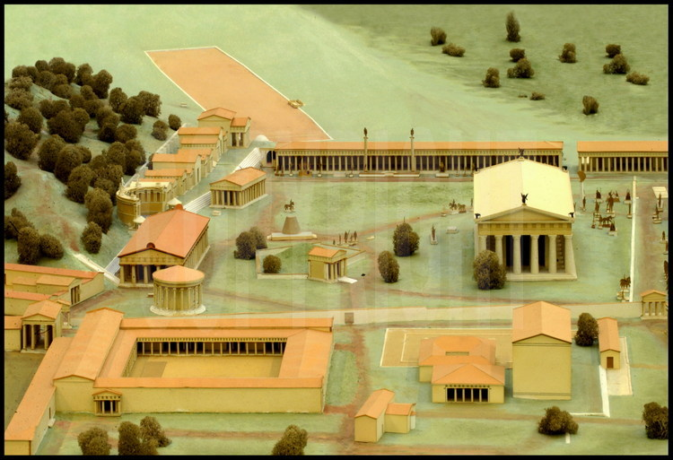 Reconstruction representing the Altis (center of Olympia's sanctuary).  Among the many buildings, we can distinguish: on the bottom left, the palestra: in the center on the right, the temple of Zeus: at the top left, the stadium: in the center left, the temple of Hera.